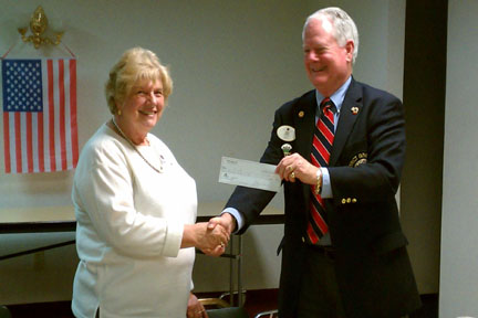 DG Chuck with Inskip Lions Club President Bonnie Peters, 11/28/2011